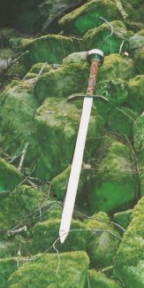 Photo of sword lying on stones